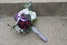 Bridesmaid bouquet with purple, ivory and lavender artificial stems. Hydrangeas, and ranunculus.