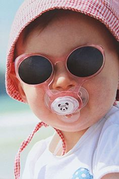 The French born, Pacifier Sunglasses by Lytot are not only unique; they are extremely functional and important to your baby's health. The patented design of attachable sunglasses to a pacifier is the perfect solution to keep kids from pulling off their sunglasses. They love their Pacifiers and keep them in place for long periods of time, and now they will do the same with their sunglasses. The absence of bands or earpieces ensures there is nothing to bother your little one at play or while…
