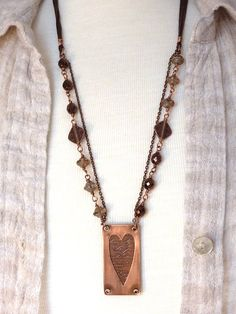Double chains are such a great way to get a layered look.  Even the etched heart is layered underneath a sheet of copper.