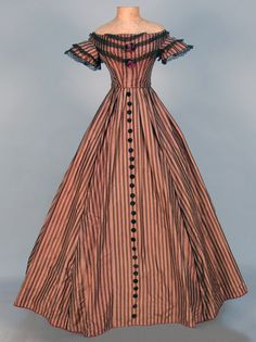 STRIPED SILK PARTY DRESS, c. 1869. [Perhaps an earlier gown that was updated. The sleeves and trim lines look like early 1860s.]