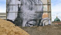 Image: A public art installation by French street artist JR on the facade of a house on Gertrauden Street in Berlin, on April 19 (© Paul Zinken/EPA/Landov)