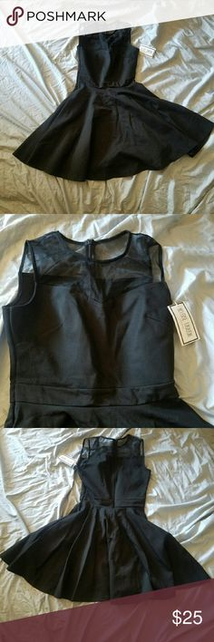 Black party dress NWT Heloise Fashion black party dress Sleeveless, A-line, sweetheart neckline and  mesh shoulders. Zipper on back that goes down to waistband detail.  97% polyester 3% elastane Heloise Fashion  Dresses