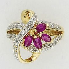 Ruby and diamond ring set in gold