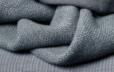 Alber from Astrid is a really thick but soft linen fabric suitable for upholstery, cushions, blankets etc. Could also make really heavy curtains.