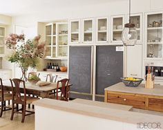 """Open"" shelving, chalkboards, bar, island, open layout ... what's not to love."