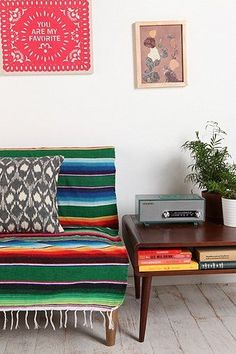 seriously love this look right now....maybe its because I am in mexico and missing all my vintage furniture back in Geogia....Mexican retro style w/ serape striped blanket