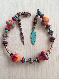SouthWestern Colorful Lampwork bracelet. Orange red, turquoise and Tibetan copper beads for accents