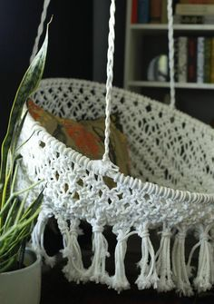 Make your very own DIY Hanging Macramé Chair. With only a few different materials and also three different kinds of knots you can have a stylish hanging chair.