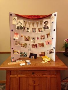 Funeral or Memorial photo board using twine, mini clothespins and a trifold board. Doesn't damage photos!