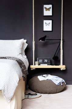 A hanging bedside table adds a modern vibe to this bedroom
