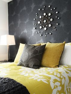 Gray and Yellow room - great starburst on wall, the grey wall and awesome accent pillow.