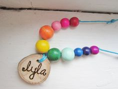 handmade name tags....perfect for a camping/ glamping or woodland fairy party! <#  http://www.etsy.com/listing/159440837/rainbow-waldorf-fairy-wooden-bead?ref=shop_home_active
