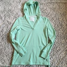 Victoria's Secret v neck hoodie small Adorable Victoria's Secret v neck hoodie! Has drawstrings on the side and can be sinched up. Color is a seafoam green/blue. Only worn a few times, super soft on the inside and comfy! Make me an offer! NO TRADES Victoria's Secret Sweaters