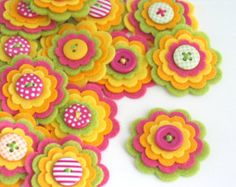 Felt flower embellishments add a special touch to your craft projects from hair accessories to decorating photo frames, purses, pillows and much more.   {D E T A I L S } * You will receive 3 x CIRCUS felt flowers. You may not receive the exact ones as shown but they will still be just as cute :) * Each one is made using 4 layers of felt with a cute button sewn on top * I use a mix of felt - acrylic, wool mix etc * The measure approx 1.5 each * The individual layers measure 1.5, 1.25, 1 and…