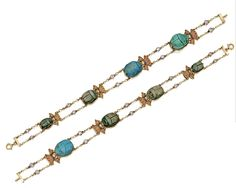 GOLD, PLATINUM AND GEM-SET EGYPTIAN REVIVAL NECKLACE AND PAIR OF BRACELETS, EARLY 20TH CENTURY. The necklace designed as a line of carved carnelian & blue faience scarabs framed by alternating lotus & serpent motifs, the detachable pendant surmounted by an old mine diamond  & suspending a scarab flanked by winged serpents, enhanced throughout with opaque enamel & variously-cut sapphires, emeralds & synthetic rubies, & completed by old European-cut & rose-cut diamonds. Matching bracelets.