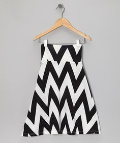 Soft and stylish, this skirt boasts a bold high-contrast print that pairs well with lots of different colored tops. A wide fold-over waistband and lightweight fabric help this piece stay put on top and drape comfortably all the way down.