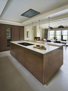 The flush stained-oak kitchen furniture incorporates fitted appliances including Gaggenau conventional, steam and microwave ovens, wine conditioning unit, fridge and freezer. Custom Made Furniture, Upcycled Furniture, Kitchen Furniture, Appliances, Ovens, Architecture, Conditioning, Case Study, Furnitures