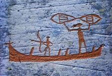 Rock Carvings from Alta in the far north of Norway. Fishermen in boat with net and bow/arrow..