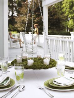 This alfresco chandelier comes together easier than it looks, but the suspended candles (or flowers!) will make an instant impression. Click through for instructions and more summer party ideas and outdoor entertaining tricks.
