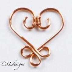 wirework heart How to make a wire wrapped pendant. Celtic wirework heart - Step 9 by laceyHow to make a wire wrapped pendant. Celtic wirework heart - Step 9 by lacey Copper Wire Art, Copper Wire Jewelry, Wire Jewelry Designs, Wire Jewelry Making, Jewelry Crafts, Jewellery Making, Jewellery Shops, Bespoke Jewellery, Damas Jewellery