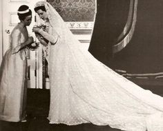 Princess Alexandra of Kent in her wedding gown and veil with her bridesmaid The Princess Anne (later The Princess Royal)