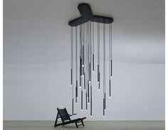 Designed by Refer   Staer, and Jesper Kongshaug, 2011. Contemporary Modular Lighting. Array is a minimalistic light with an aesthetic expression and complex uses. Array consists of an angled base and eight pendants. LED lights are recessed in the pendant rods.The matte acrylic tubes provide a calm, diffused light whereas the down light generates a powerful focused beam.Latest LED technology provides a luminous intensity that meets today