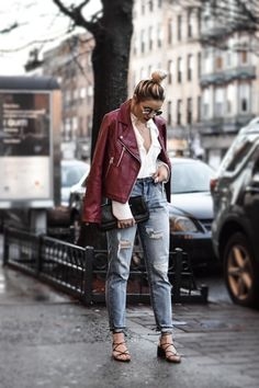 279dad759 Burgundy moto leather jacket, White blouse, Ripped/distressed and cuffed  boyfriend jeans, Strappy black sandals