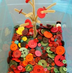 Fall themed fine motor activity.  This button tree sensory and fine motor bin would make a great center this fall in your special education classroom.
