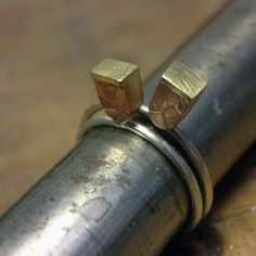 embossed copper, silver and brass stacking rings by papermetal https://www.facebook.com/papermetal