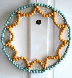 Great wooden bead wreath from decor hacks
