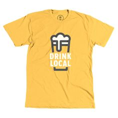 """""""Drink Local"""" designed by Nick Signet. This is that local beer shirt that your mom has always wanted you to have. Make your mom proud and show your support for the local breweries we all love. Oh, and if I see you out with this shirt on I will buy you a beer. If that isn't incentive enough then I just don't know what is."""