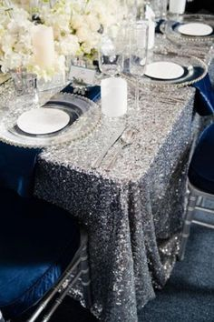 cute silver sequin and white flowers winter wedding table setting