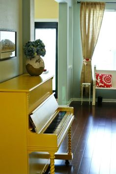 Painted pianos via Apartment Therapy. This room has almost exactly the same layout as our dining room/kitchen, piano placement and all. Taking notes!