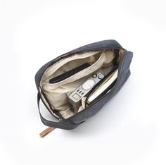 If you need something to store the small stuff, the brand new QWSTION Travel Kit is the perfect add-on for the road. The small piece of luggage comes in our signature-coated canvas. Camera Pouch, Customised Gifts, Travel Kits, Travel Essentials, Valentine Day Gifts, Shoe Bag, Bags, Collection, Pockets
