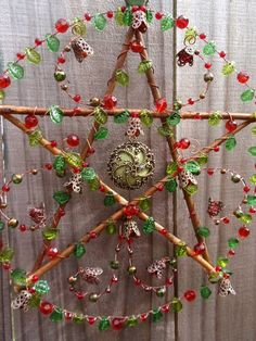 Yuletide Spirit. Mixed media pentacle with willow branches, wire, glass, and metal. Handmade by KM Fields.