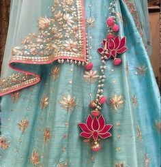 The ultimate list of gorgeous Lehenga and Blouse Latkan designs that are ruling the internet. From tassels to pom-pom designs, choose not just one but more. Red Lehenga, Bridal Lehenga, Gota Patti Lehenga, Lehenga Kurta, Lehenga Style, Sharara, Indian Dresses, Indian Outfits, Indian Clothes