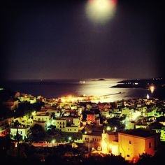 Beautiful Ermoupoli by night , in Syros island (Σύρος) . Magical lights and the moonlight over the sea
