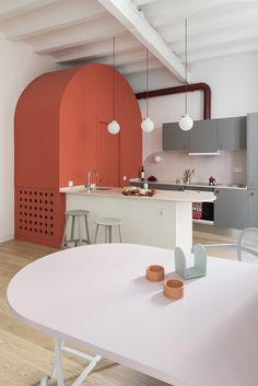 Kitchen Interior Design Deep-blue cabinetry and coral-pink arches redefine Barcelona apartment
