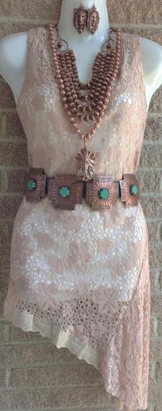 Love this!  http://www.shop-southern-charm.com/collections/frontpage/products/tan-sleeveless-vintage-lace-tunic-top