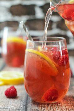 Raspberry-Lemon Blush Sangria Spritzers - The Wanderlust Kitchen Raspberry-Lemon Blush Sangria Spritzers - The Wanderlust Kitchen It i. Cocktails, Party Drinks, Cocktail Drinks, Fun Drinks, Alcoholic Drinks, Beverages, Sangria Recipes, Cocktail Recipes, Gourmet