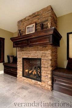 bench seats flanking fireplace