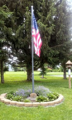 landscaping with flag pole