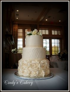 Elegant wedding cake with rosettes, ribbon and textured buttercream, white rose topper - www.cindyscakery.com // Flowers: Williamsburg Floral // Venue: #Ford'sColonyCountryClub #WilliamsburgVirginia