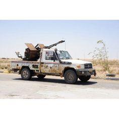A Free Libyan Army pickup truck with a ZPU-1 anti-aircraft gun Ajdabiya Libya Canvas Art - Andrew ChittockStocktrek Images (35 x 23)