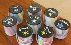 Cheap and easy party favor idea that only cost $1. She spray painted the lids with chalkboard paint and then put each kids name on there. I love this fun idea! Cute end of school gift for classmates. Fun to give at all summer events like family reunions and bbq's. Great activity to keep kids busy during the party as well! :)