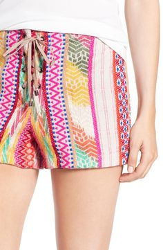 Technicolor woven stripes and a lace-up fly add to the bohemian charm of this statement-making shorts.