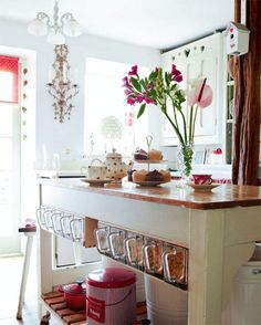 I love the under-cabinet storage. I would love to have an island with a breakfast bar, where the work surface is lower than the bar. Then these containers an be housed under the bar for easy prep work.