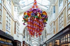 Artist Zoe Bradley creates stunning artworks entirely from paper. Artist Zoe Bradley uses pieces of paper flowers were used to create paper floral chandeliers.