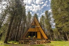 It's a classic A-frame cabin reimagined with a sleek style. The open floor plan and walls of windows bring the serene surroundings indoors, day and night.