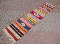 Check out this item in my Etsy shop https://www.etsy.com/listing/526042811/handmade-vintage-turkish-kilim-rug-wool